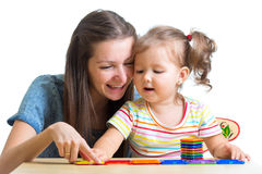 Child and mom playing together with toys Stock Photo