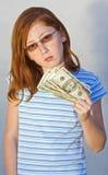 Child with money. Girl holding 20 dollar bills Royalty Free Stock Photos