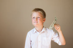 Child with money (20 dollars) Royalty Free Stock Images