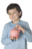 Child with moneybox savings. Adorable child with moneybox savings isolated over white Royalty Free Stock Image