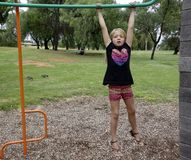 Child on Monkey Bars. Royalty Free Stock Photo