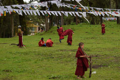 Child monks playing. Outside the tawang monastery Stock Images