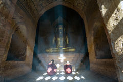 Child Monks Pray inside a pagoda - Bagan, Myanmar Stock Images