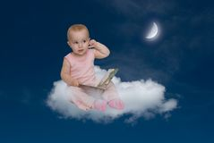 The child and the moon. The moon helps to study (to acquire mystical knowledge Stock Photography