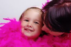 Child with mother. Beautiful girl (2 years old) with his mother and boa Stock Image