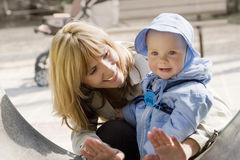 Child and Mother. Portrait of little baby and mother. Sunny day in park Stock Photo