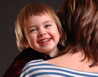 Child with mother. Mother holding her smiling child Stock Images