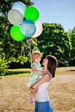 Child and mother with balloons Stock Photos