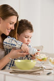 Child with mother on breakfast Stock Photography