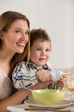 Child with mother on breakfast Royalty Free Stock Photo