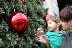 Child with mother at christmas tree Stock Image