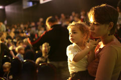 Child with mother in the cinema Royalty Free Stock Images