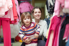 Child with mother at clothes shop Royalty Free Stock Photos