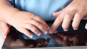 Child and mother with digital tablet Stock Images
