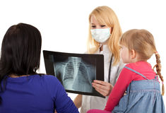 Child with mother at doctor Stock Photo