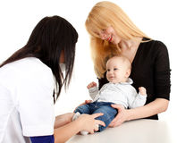 Child with mother at doctor Stock Image
