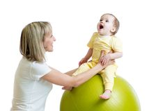 Child and mother doing yoga with fitness ball. Child girl and mother doing yoga with fitness ball Royalty Free Stock Photography