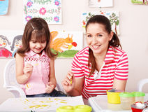 Child with mother draw paints. Stock Photo