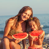 Child with mother eating watermelon Royalty Free Stock Image