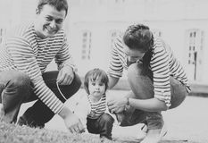 Child with mother and father in the park. Black and white. Royalty Free Stock Photography