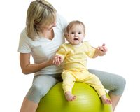 Child and mother with fitness ball. Child and mom do gymnastics with fitness ball Royalty Free Stock Images