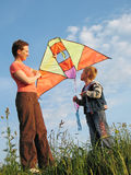Child and mother fly kite royalty free stock photos
