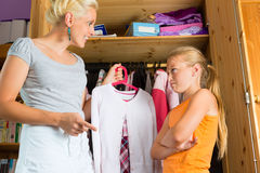 Child and mother in front of closet Royalty Free Stock Image