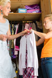 Child and mother in front of closet Royalty Free Stock Images