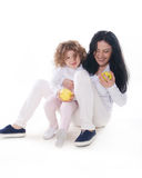 The child with mother holding apple isolated Royalty Free Stock Photos
