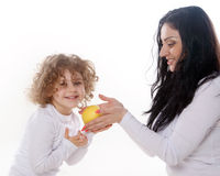 The child with mother holding apple  Royalty Free Stock Image