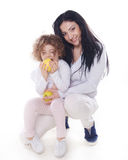 The child with mother holding apple  Stock Photography