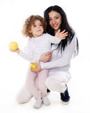 The child with mother holding apple  Stock Images