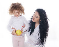 The child with mother holding apple  Stock Image