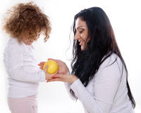 The child with mother holding apple  Royalty Free Stock Photo