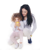 The child with mother holding apple  Royalty Free Stock Photos