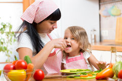 Child and mother on kitchen. Child Girl and mother on kitchen royalty free stock photography