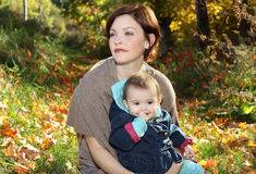Child and mother outdoor during fall Royalty Free Stock Photography