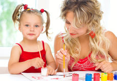 Child with mother painting Stock Images