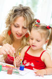 Child with mother painting Royalty Free Stock Photos