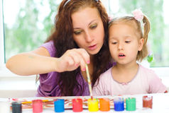 Child with mother painting Stock Photos