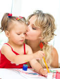 Child with mother painting Royalty Free Stock Photo