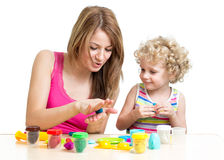 Child and mother play colorful clay toy Royalty Free Stock Image