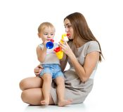 Child and mother play musical toys isolated Stock Photo