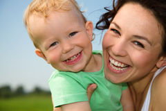 Child with mother play outdoors Stock Images