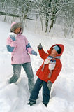 Child and mother play on snow Royalty Free Stock Photos