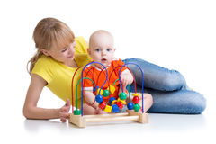 Child and mother playing with educational toy Royalty Free Stock Images