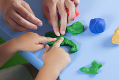Child and mother playing with playdough Stock Photography