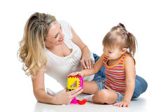 Child and mother playing together with puzzle toy Royalty Free Stock Photo
