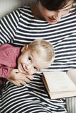 Child with mother are reading a book Royalty Free Stock Images