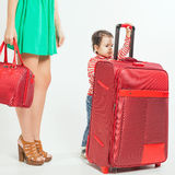 Child with mother ready to travel Stock Photos